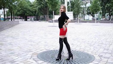 Girl in a red short dress and boots