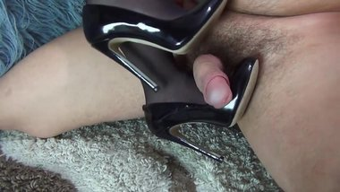Creaming her nylons feet and high heels