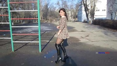 Russian MILF dance in overknee boots and short skirt