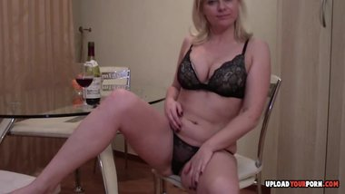 Blonde wife masturbates with wine bottle