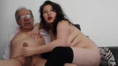 A young woman masturbate an old man and he finished