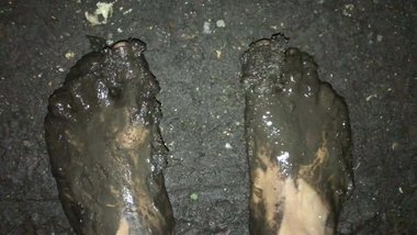 Walking around barefoot in the mud