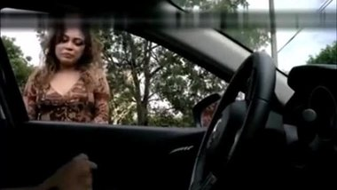 Latina girl masturbates a driver through the window