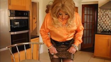 orange satin blouse and leopard print skirt