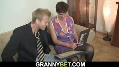 Old granny in black stocking rides horny cock