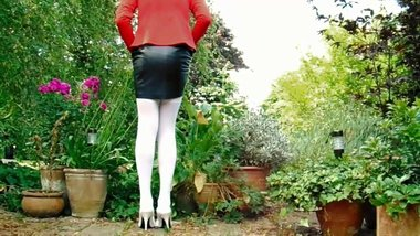 Black Leather Miniskirt White Nylon Stockings